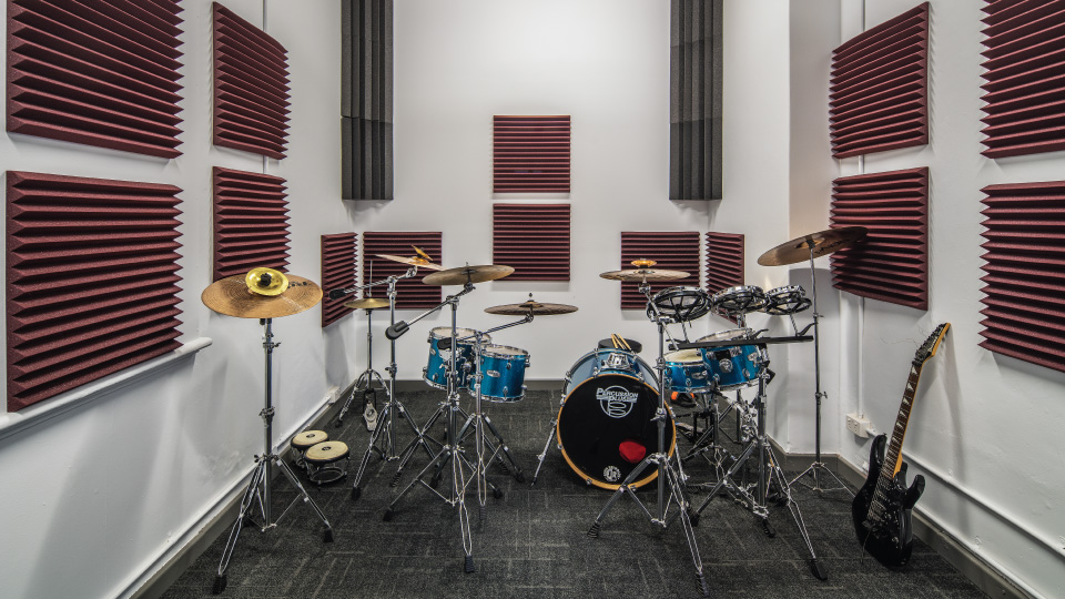 """With a drum kit, multiple upright pianos and a baby grand piano to name a few, our music rooms are an excellent place to practice. We also have dedicated art spaces and our """"Room of Requirement"""" is stocked with art supplies, cardboard, hot glue gun, sewing machine and much more to help you explore your creative side."""